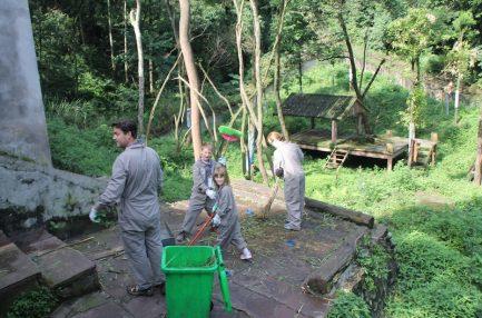 volunteer vacations - panda pen cleaning