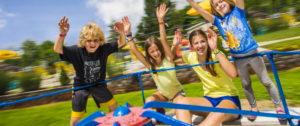 family travel and camping - Kids at a KOA playground